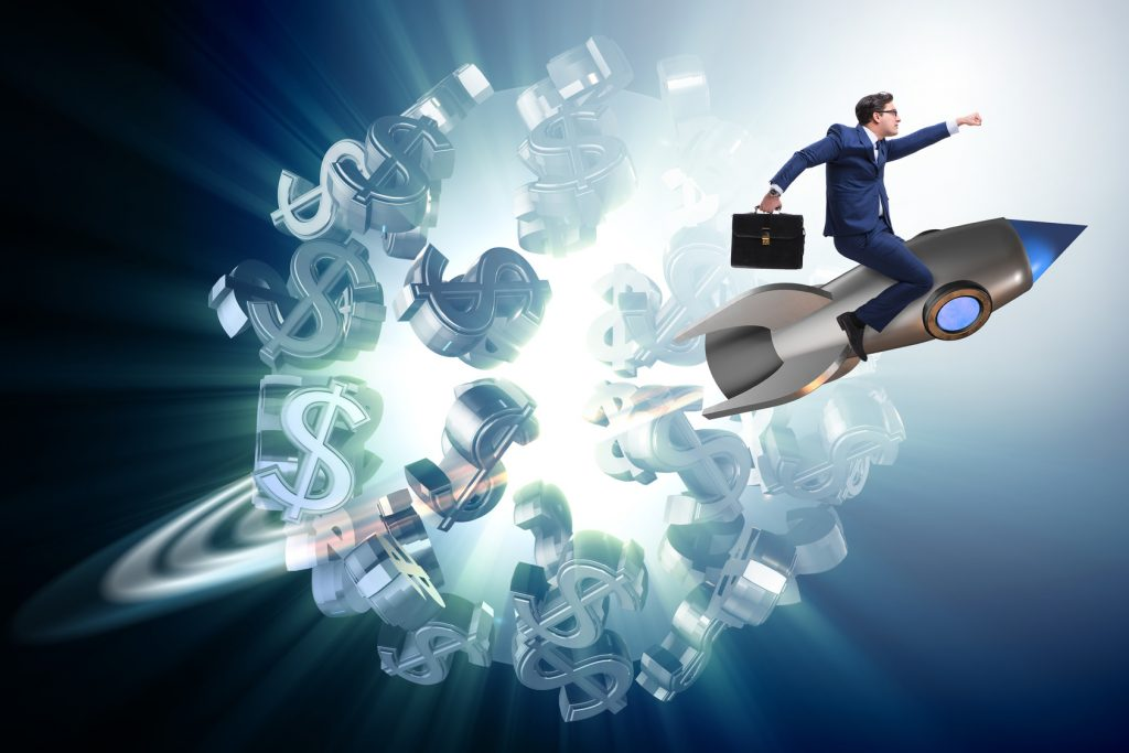 Businessman on rocket flying around dollar